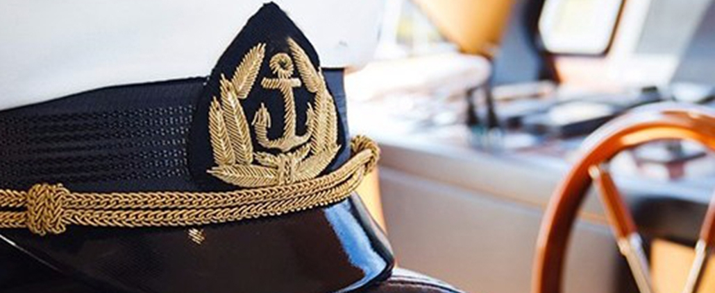 View of a captains hat in the bridge of a yacht